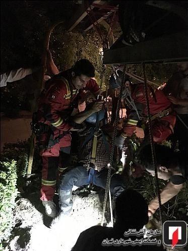 گزارش تصویری/ نجات  پس از سقوط به چاه 50 متری در دیباجی شمالی تهران